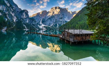Photo of  Lake Braies (Lago di Braies) in Dolomites Mountains, Boat hut on Braies Lake with Seekofel mount on background, Sunrise of Italian Alps, Naturepark Fanes-Sennes-Prags, Dolomite, Italy, Europe.