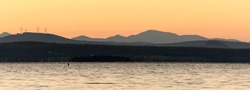 Lake Champlain in Vermont at sunset with mountains in the background