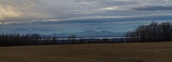 Lake Champlain in winter. Beautiful Mountain Panorama near Split Rock Mountain seen from Vermont.
