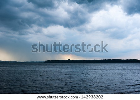 lake chiemsee with heavy weather rain clouds