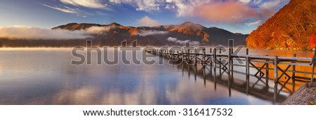 Lake Chuzenji (Chuzenjiko) near Nikko in Japan. Photographed on a beautiful still morning in autumn at sunrise.