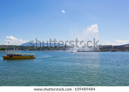 Lake Geneva featuring the Jet d'Eau with a ferry in the foreground
