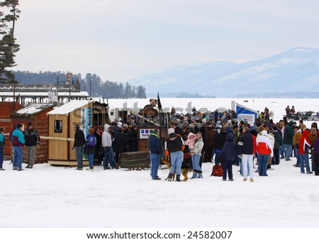 LAKE GEORGE, NY - February 7, 2009: Teams lining up, waiting for the start of the outhouse races on the ice at the February 7 , 2009 Lake George Winter Carnival.