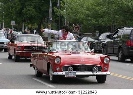 LAKE GEORGE, NY - MAY 30 : An Elvis impersonator rides in the Elvis Classic Car Parade during the 2009 Lake George Elvis Festival May 30, 2009 in Lake George, NY.