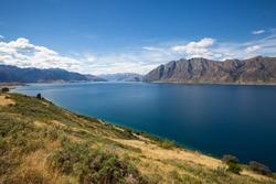 Lake Hawea in New Zealand between mountain walls