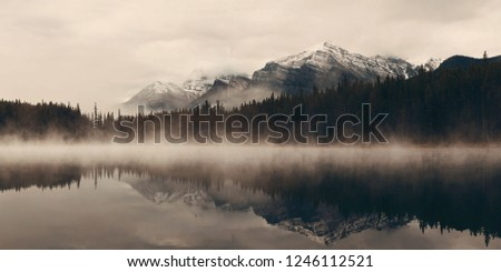 Lake Herbert panorama in a foggy morning with glaciers mountain and reflection in Banff National Park, Canada #1246112521