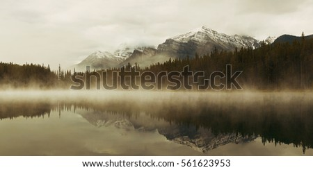Lake Herbert panorama in a foggy morning with glaciers mountain and reflection in Banff National Park, Canada #561623953