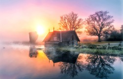 Lake house in the morning fog. Early morning fog on lake house. Lake house in morning fog. Lake house at dawn