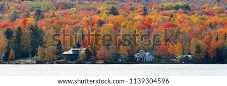 Lake house with Autumn foliage and mountains in New England Stowe