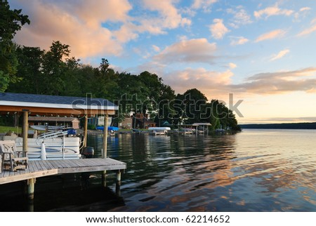 Lake house with pier and woods with sunrise in the morning in New York state Finger Lakes