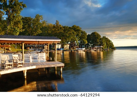 Stock Photo Lake house with pier and woods with sunrise in the morning in New York state Finger Lakes