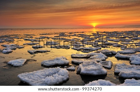 Lake Huron Sunrise - floating ice in this Lake Huron Winter scenic , Port Hope, Michigan USA
