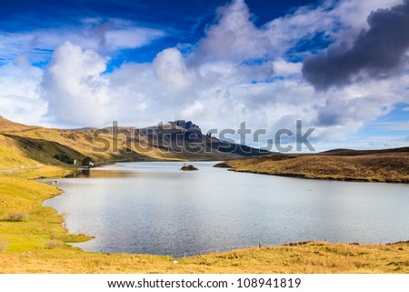 Lake in a desolate mountain landscape on a sunny day