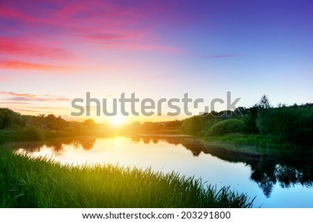 Shutterstock Lake in forest at sunset. Peaceful and calm mood. Romantic sky with red clouds