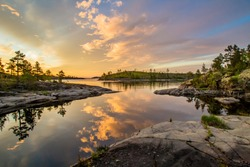 Lake in Karelia. Russia. Lake Ladoga at dawn. Nature regions of Russia. Skers of Lake Ladoga. Tourism Russia. Landscapes of Northern Nature. Rocky coast of Ladoga. Guide to Karelia. Russian north