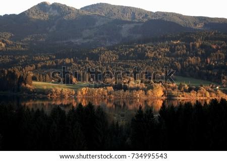 Lake in the Alpine Upland, beautiful autumn foliage, Bavaria, evening mood #734995543