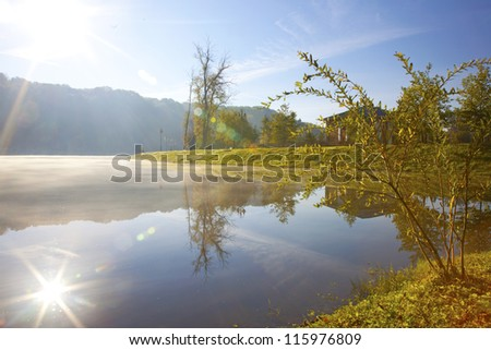 Lake in the early autumn morning - stock photo