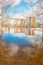 Lake in the park. Flooding of the city in spring. Water and blue sky. Reflection of the sky in the water. The city was flooded with melt water.