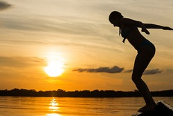 lake jump young woman jumping into the lake against sunset lake jump happy water vacation summer nature active outdoor female activity swim ecuador outside travel athletic people jumping girl woman ho