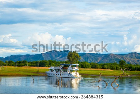 Lake Kariba Dam Reflections On the Water.  House Boat and Clouds.