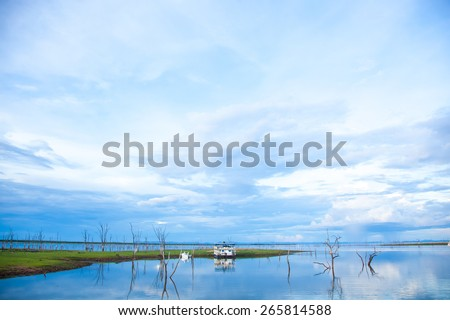 Lake Kariba Dam. Reflections On the Water.  House Boat and Clouds.