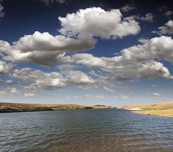 Lake - lake in Alberta's prairies with clouds and blue sky (Chain Lakes Prov.Park in Alberta, Canada)