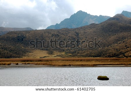 Lake Limpiopungo, with the Ruminahui mountain in the background, on a cloudy day. The Andes, Ecuador, South America.