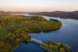 Lake Lipno. Czech countryside at lake Lipno. Houses and small railroad bridge crossing lake lipno near Sumava national park. Lake Lipno, czech republic.