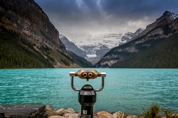 Lake Louise, Alberta, Banff National Park, Canada, with coin operated binoculars in the foreground