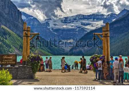 LAKE LOUISE, CANADA - AUG 06, 2012: View of the famous lake Louise from Fairmount Chateau Lake Louise Hotel. Lake Louise is the second most-visited destination in the Banff National Park.