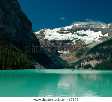 Lake Louise - this amazing big lake is located in the Banff National Park, Alberta, Canada. It\'s surrounded by high mountains with snow all year. It\'s also well known for the excellent ski resorts.