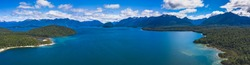 Lake Manapouri in Fiordland National Park Ultra wide panorama of mountain and lake landscape on a sunny day near Te Anau in Southland New Zealand