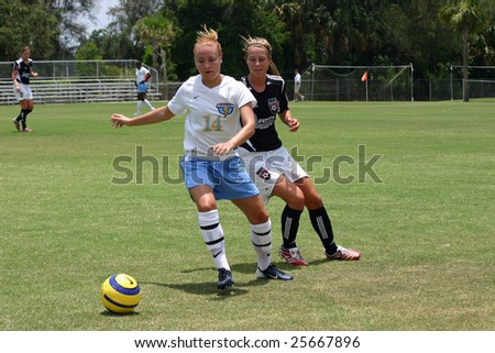 LAKE MARY, FL - CIRCA JULY 2007: Holly Peltzer #14 Central Florida Strikers fights for ball control during a women's World Premier Soccer League Game vs Tampa Bay Elite circa July 2007 in Lake Mary, Florida. - stock photo