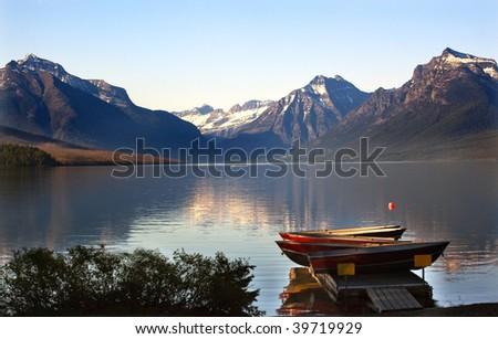 Lake McDonald Boats Snow Mountains at Glacier National Park