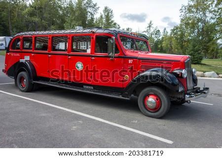 LAKE MCDONALD LODGE, GLACIER NATIONAL PARK/USA - SEPTEMBER 21 - Red Bus in Glacier National Park Montana on September 21, 2013