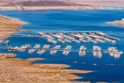 Lake Mead marina shot from a distance. Illustrates low water level from decades long drought in the southwest.