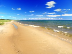 Lake Michigan beach on a warm summer day seen from the Upper Peninsula of Michigan