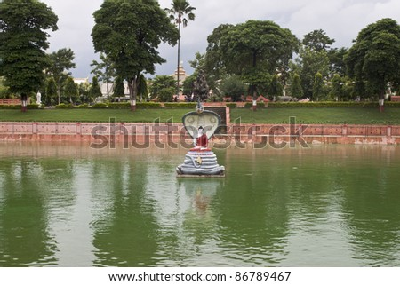 Lake next to Mahabodhi temple in Bodhgaya, India. Bodhgaya is the place where Buddha got enlightenment after seven weeks of meditation , so it's the most sacred place of Buddhism. - stock photo