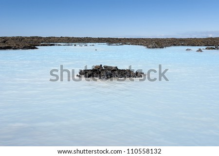 lake of boiling water over the blue lagoon in Iceland