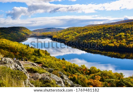 Photo of  Lake of the Clouds in Porcupine Mountains Wilderness State Park, Michigan's largest state park. Amazing natural beauty in fall season and gorgeous blue clouds reflection in water.