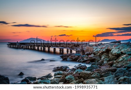 Lake pier on the background of sunset. Sunset lake pier landscape. Lake pier at sunset. Beautiful sunset on lake pier Foto d'archivio ©