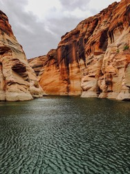 Lake Powell is a reservoir on the Colorado River, straddling the border between Utah and Arizona. Second largest man-made reservoir by maximum water capacity, created by the flooding of Glen Canyon.