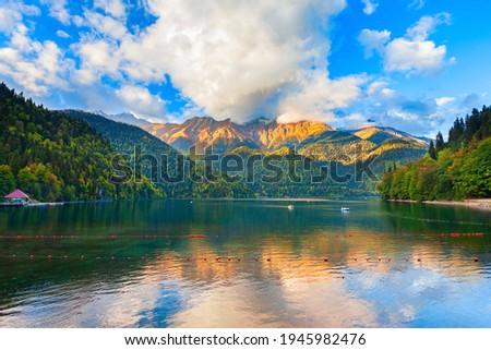 Lake Ritsa panoramic view at sunset. Lake Ritsa is a lake in the Caucasus Mountains in Abkhazia region, Georgia.