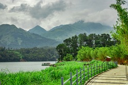 lake serene with beautiful hiking trails and mountain background image is taken at banasura sagar dam wayanad kerala india. the natural beauty of this place is amazing.