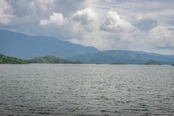 lake serene with beautiful mountain background image is taken at banasura sagar dam wayanad kerala india. the natural beauty of this place is amazing.