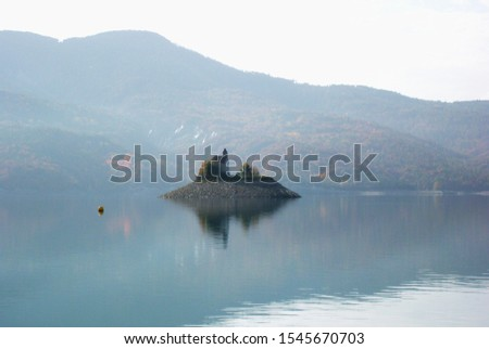 Lake Serre-Ponçon. Beautiful Alps mountain lake in southeast France. Reservoir in the departments of Hautes-Alpes and Alpes-de-Haute-Provence. #1545670703