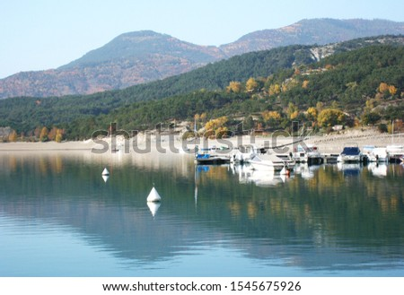 Lake Serre-Ponçon. Beautiful Alps mountain lake in southeast France. Reservoir in the departments of Hautes-Alpes and Alpes-de-Haute-Provence. #1545675926