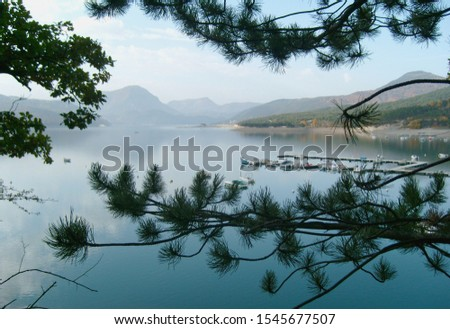 Lake Serre-Ponçon. Beautiful Alps mountain lake in southeast France. Reservoir in the departments of Hautes-Alpes and Alpes-de-Haute-Provence. #1545677507