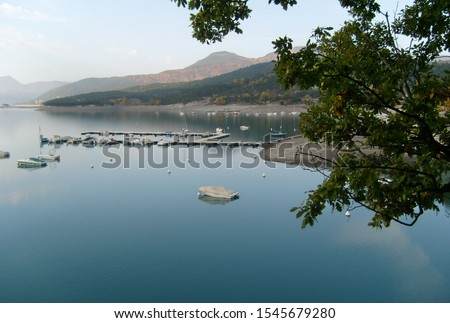 Lake Serre-Ponçon. Beautiful Alps mountain lake in southeast France. Reservoir in the departments of Hautes-Alpes and Alpes-de-Haute-Provence. #1545679280