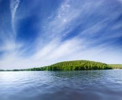 Lake shore under blue sky